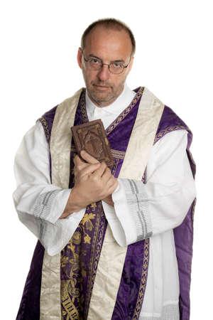 Photo pour a catholic priest with bible in worship - image libre de droit