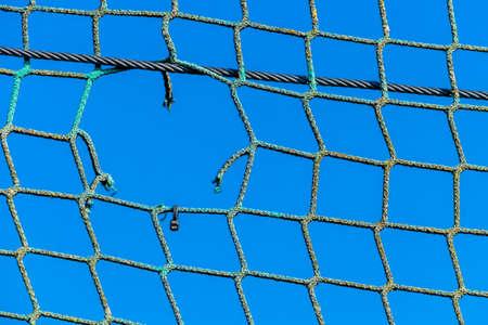 Photo pour hole in a net, symbolizing captivity obstacle hope damage - image libre de droit