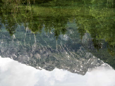 austria, upper austria, schiederweiher. mountain reflected in lake. in the reflection you see on the bottom of the lake