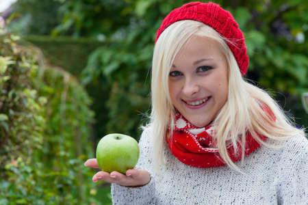 woman with apple. vitamins autumn