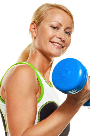woman with dumbbells during training for strength