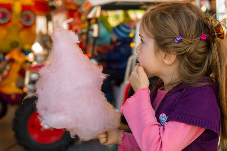 child with cotton candy
