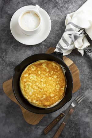 Photo for Omelette in frying pan and cup of coffee. - Royalty Free Image