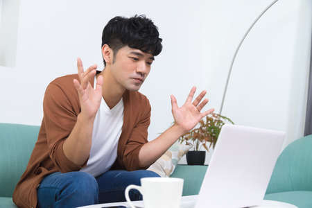 Photo pour Man talking on video conference online with laptop at home. Study on online distant course. Talk on video call with friend or relative. - image libre de droit