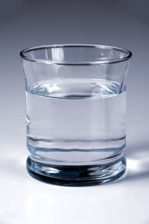 Glass of clean water over a gradient background