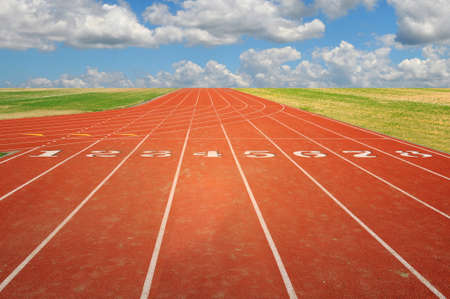 Running track with eight lanes with sky and clouds