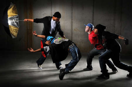 Hip hop men performing and act over an urban background