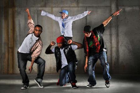 Hip hop men dancing over a grunge background