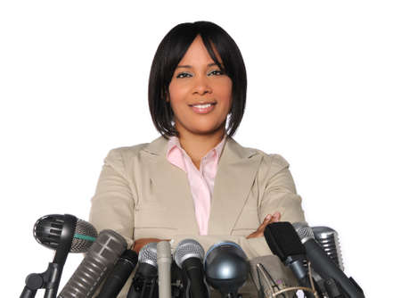 African American woman in front of microphones isolated over white