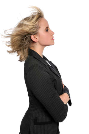 Profile of beautiful businesswoman with hair blowing
