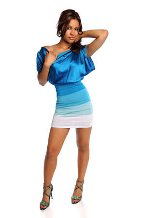 Portrait of beautiful Hispanic woman in blue dress and heels isolated over white background