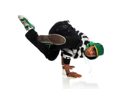 Portrait of African American hip hop dancer balancing on hands isolated over white background