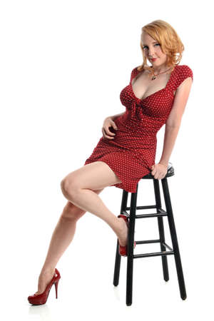 Portrait of pin up girl in red dress isolated over white background