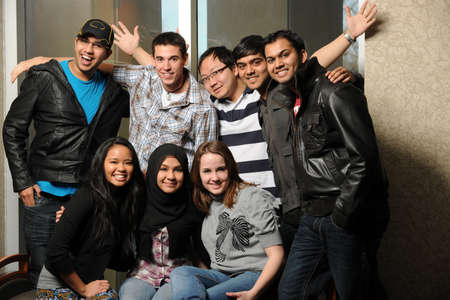 Group of diverse students smiling indoors