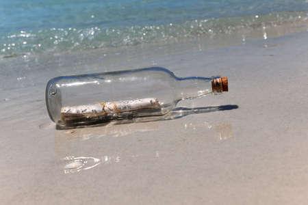 Message in a bottle on sandy shore