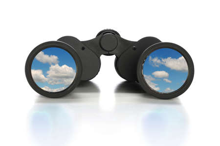 Binoculars with image of clouds over reflective table