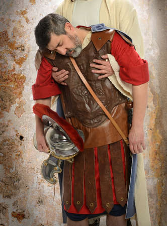 Jesus hands holding exausted Roman soldier