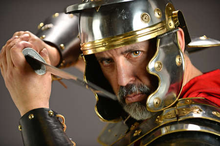 Menacing Roman soldier holding sword