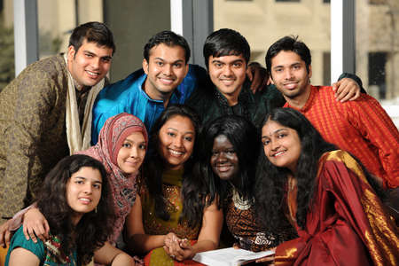 Photo pour Group of diverse college students dressed in traditional attire - image libre de droit