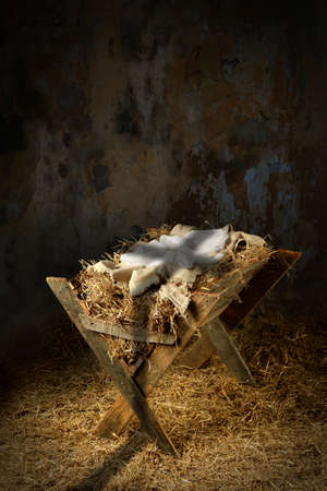 Photo for Empty manger with shadow of cross in old dirty barn - Royalty Free Image