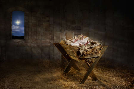 Photo pour Jesus resting on a manger while light from the star filters into the room - image libre de droit