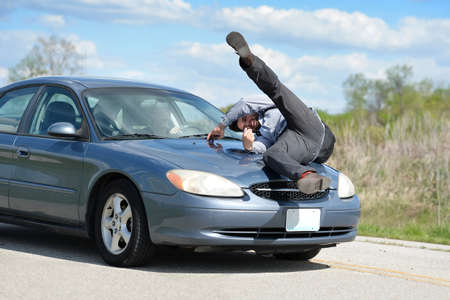 Photo for Man being hit by car driven by young woman - Royalty Free Image