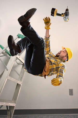Photo for Worker falling from ladder inside room - Royalty Free Image