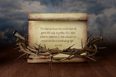 Photo for John 3:16 scroll surrounded by crown of thorns and nails - Royalty Free Image