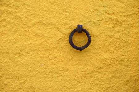 The close-up of an anchor ring on a house facade