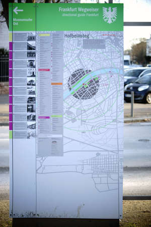 Frankfurt, Germany - January 05, 2017: An information board and city map with directions to the sights and the old town on the shore Museum on January 05, 2017 in Frankfurt.
