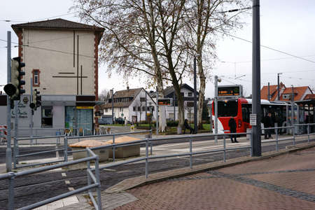 Griesheim, Germany - December 02, 2017: A bus stop at Bar-le-duc square next to tram rails on December 02, 2017 in Griesheim.