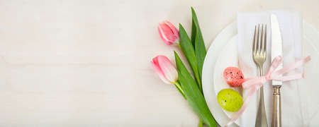 Photo for Easter table setting with pink tulips on white wooden background. Top view, banner, space for text - Royalty Free Image