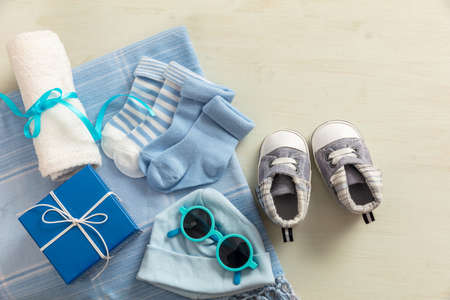 Baby boy shower concept on wooden background, copy space, top view