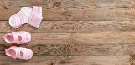 Photo pour Baby girl shower concept on wooden background, copy space, top view - image libre de droit