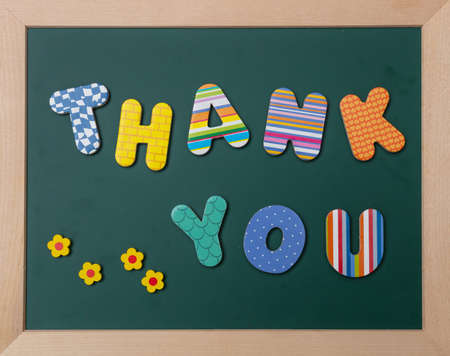 Foto für Thank you, Colorful letters shaping the word thank you on green board with wooden frame - Lizenzfreies Bild
