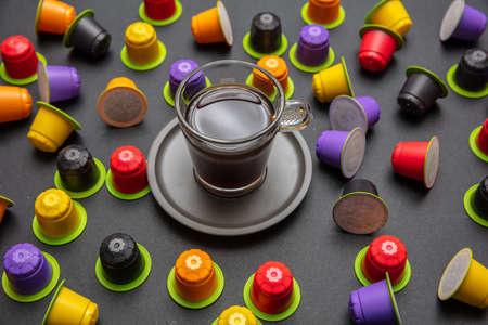 Photo pour Coffee cup and capsules, eco friendly, compostable on black color background - image libre de droit