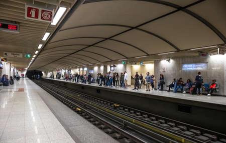 Photo pour April 14, 2019. Greece, Athens. Metro station at the city center. Passengers at the platforms waiting for the trains to come - image libre de droit