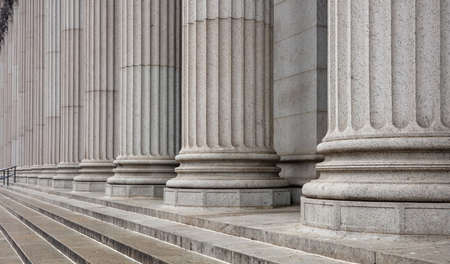 Stone colonnade and stairs detail. Classical pillars row in a building facade