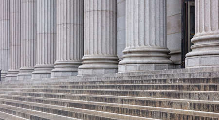 Photo pour Stone colonnade and stairs detail. Classical pillars row in a building facade - image libre de droit