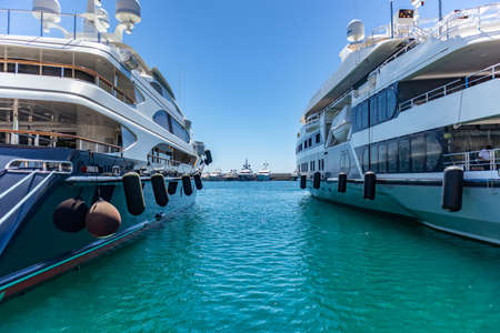 Photo for April 29, 2019. Marina Zeas in Piraeus, Greece. Luxury yachts moored at harbor ready to sail. Blue sky and sea background, space. - Royalty Free Image