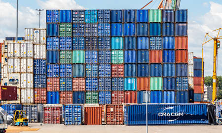 Photo for Rotterdam harbor, Netherlands. July 2nd, 2019. Logistics business. Stacked containers, and machinery, international port of Rotterdam, sunny summer day - Royalty Free Image