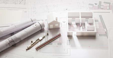 Foto de Residential building project architectural design, blueprint plans and house model, banner - Imagen libre de derechos