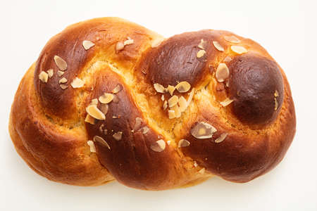 Photo pour Sweet bread, easter tsoureki cozonac isolated on white background, top view. Braided brioche, festive traditional challah - image libre de droit