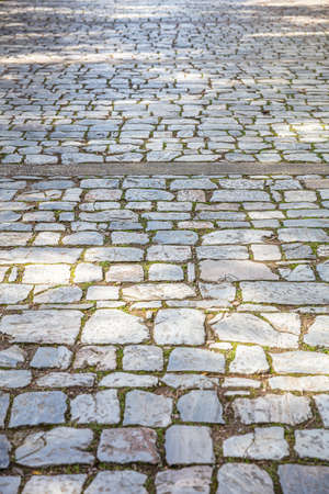 Photo for Old stone marble paved footpath, cobblestone pathway background, texture. Perspective high angle view - Royalty Free Image