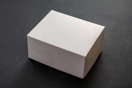 Photo pour Package box rectangle, blank advertise template for products packaging. White color empty closed cardboard container against black background - image libre de droit