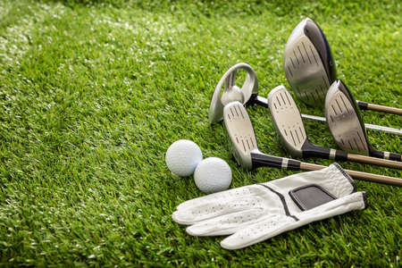 Photo for Golf equipment, sticks set, glove and golfballs on green course lawn, close up view. Golfing sport and club concept - Royalty Free Image