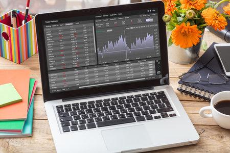 Photo pour Trade platform, forex trading. Stock exchange market analysis, monitoring app on laptop screen, office desk background. Binary option, candlestick chart. - image libre de droit