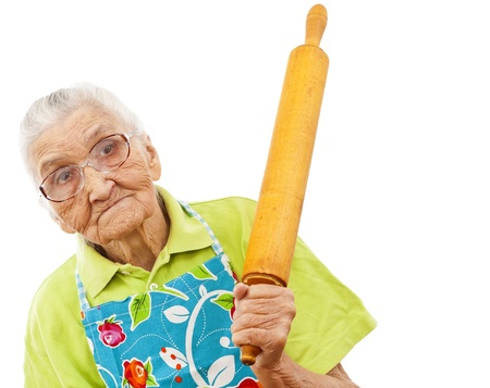old woman with isolated background holding a rolling pin in her hand