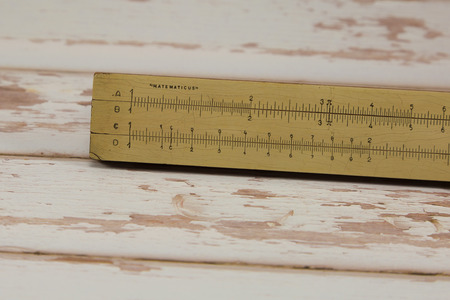 Wooden Vintage Slide Rule: Mathematical Calculator - School Education Theme.