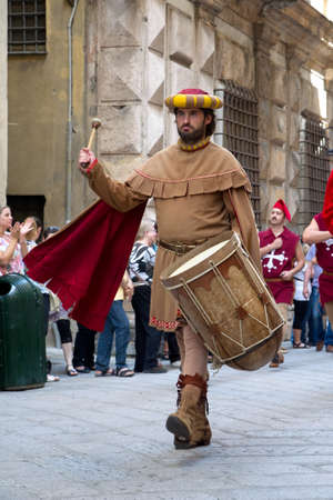 GENOA, ITALY - 8 JUNE 2014 - Unidentified people during the historical parade of the Maritime Republics Palio